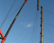 new flare stackand guy wires, erecting and tensioning